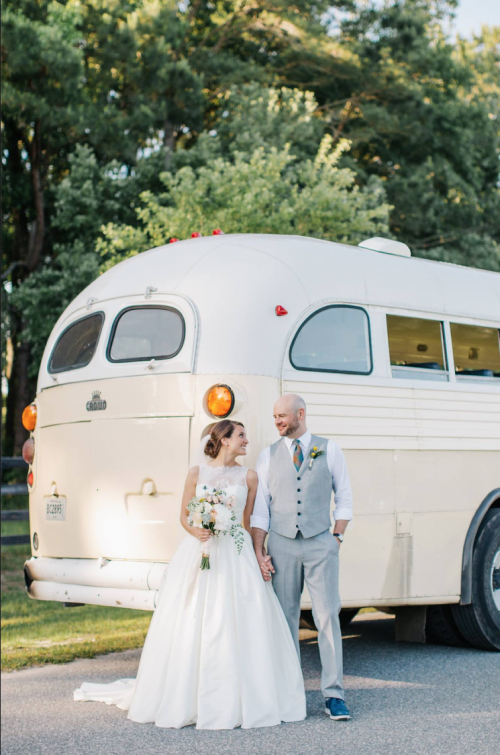 wedding couple next to vintage bus